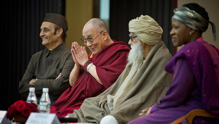 His Holiness the Dalai Lama greeting the audience at an interfaith program titled On World Religions: Diversity, Not Dissension in New Delhi on 9 March 2013. (Photo/Tenzin Choejor/OHHDL)