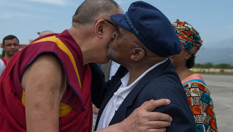 His Holiness the Dalai Lama exchanging greetings with his old friend Archbishop Desmond Tutu on the Archbishop's arrival at the airport in Dharamsala, HP, India on April 18, 2015. (Photo by Tenzin Choejor/OHHDL)