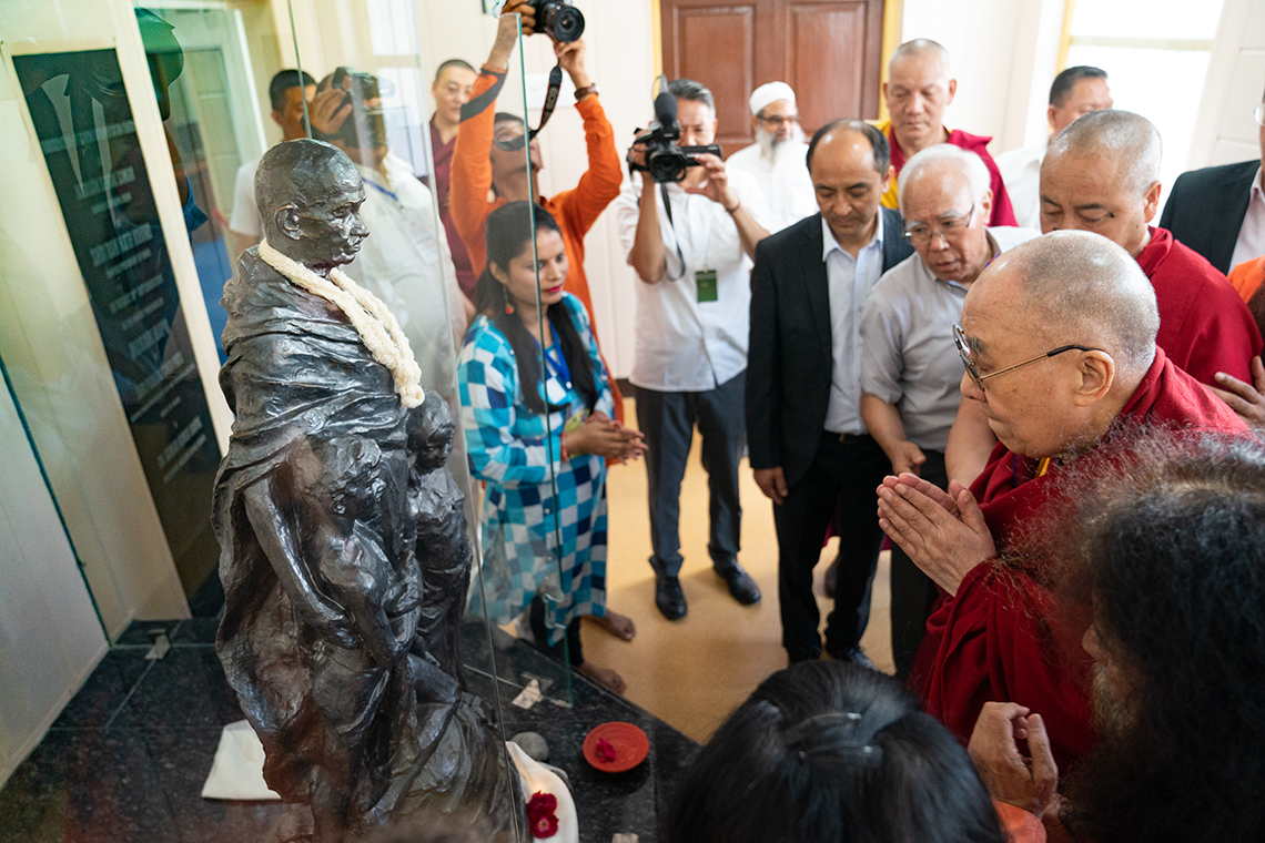 His Holiness the Dalai Lama paying his respects to a statue of Mahatma Gandhi during his visit to the Mahatma Gandhi Library at Gandhi Ashram, Kingsway Camp, New Delhi, India on September 25, 2019. Photo by Tenzin Choejor