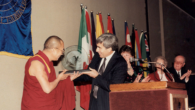 His Holiness the Dalai Lama accepting the Distinguished Peace Leadership Award from David Krieger, Executive Director of the Nuclear Age Peace Foundation, in Santa Barbara, California, USA on April 6, 1991.