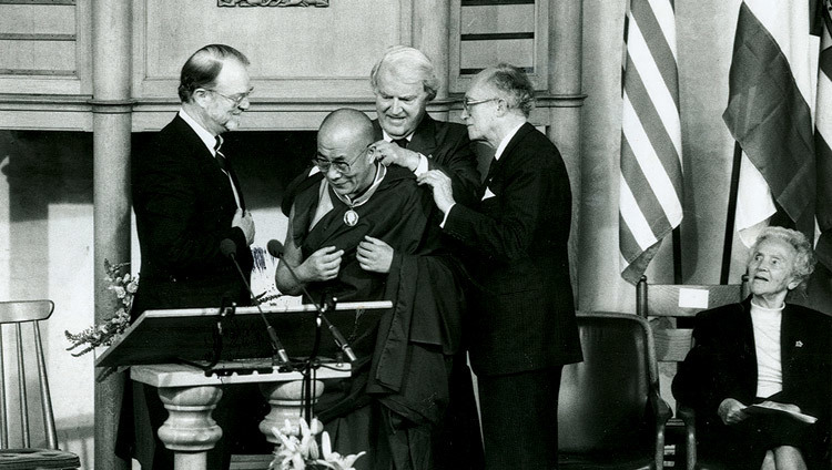 His Holiness the Dalai Lama being presented with the Franklin D. Roosevelt Freedom Medal by William J. Vanden Henvel, President of the Franklin and Eleanor Roosevelt Institute in Middelburg, USa, on June 4, 1994.