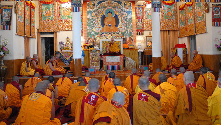 His Holiness the Dalai Lama giving ordination vows at his residence in Dharamsala, HP, India in 2010. (Photo by Tenzin Choejor/OHHDL)