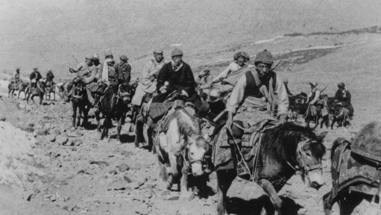 The 14th Dalai Lama fleeing Tibet into exile with Khampa (men from the Eastern province of Kham) bodyguards in March, 1959. (Photo/OHHDL)
