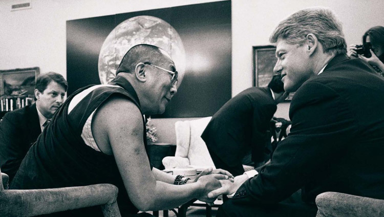 US President Bill Clinton talks with His Holiness the Dalai Lama as Vice President Al Gore looks on during a meeting at the White House in Washington DC, USA on April 27. 1993. (Official White House Photo)