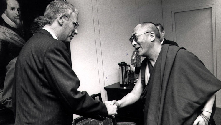 His Holiness the Dalai Lama greeting Minister of Foreign Affairs of The Netherlands Hans van den Broek in Amsterdam, the Netherlands on September 10, 1990.
