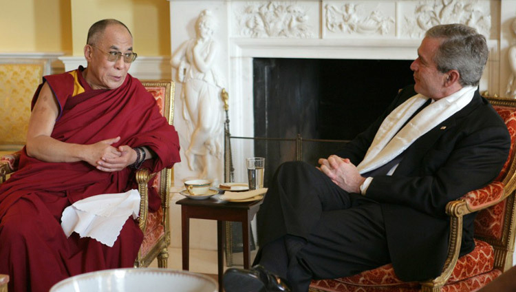 US President George W Bush wearing a scarf that was presented to him by His Holiness the Dalai Lama at the White House in Washington DC, USA on November 9, 2005. (Official White House Photo)