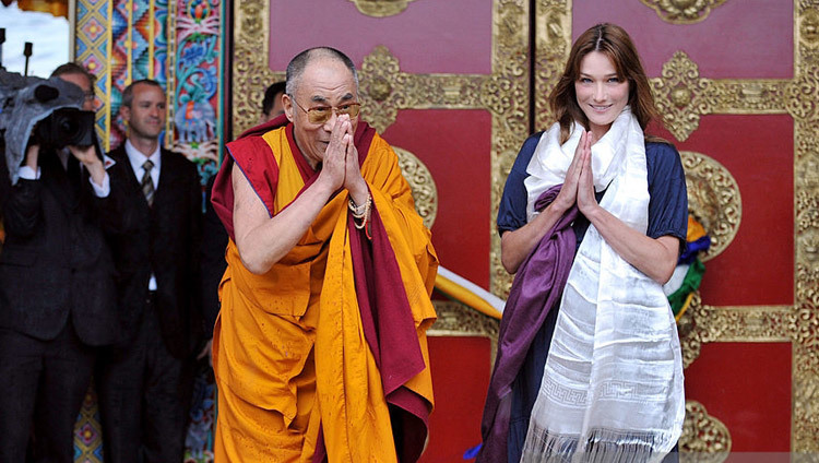 His Holiness the Dalai Lama with First Lady of France Carla Bruni Sarkozy at the inauguration of the Lerab Ling Temple in Roqueredonde, France on August 22, 2008.